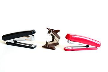 Red and black stapler, staple remover. Isolated. White background.