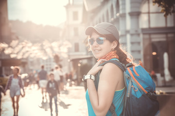 Photo of smiling woman with backpack