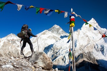 Mount Everest with tourist and prayer flags