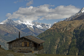 Valais snow covered mountains, small wooden hut or cabin, glacier in background, autumn, sun, clouds, colors, forest, travel, countries of Lotschen, Goppenstein, Jungfraujoch, Bern, Alps, Switzerland