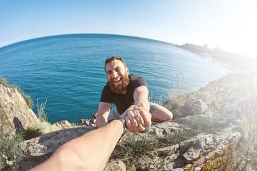 man shows a heavy climbing on a rock