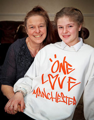 Amelia Thompson, 12, who has received an invitation to the wedding of Britain's Prince Harry and Meghan Markle at Windsor Castle next month poses for a portrait with her mother Lisa Newton in Sheffield