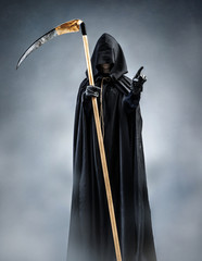 Grim Reaper points at you. Photo of silhouette grim reaper with pointing finger. Death