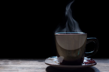 Hot coffee on the wooden table.