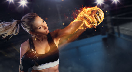 Young blond woman with fire fist