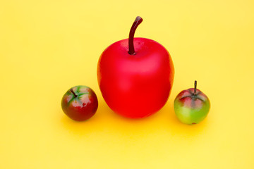 Decoration - red green apples on yellow background
