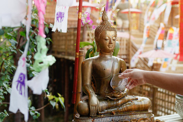 Sprinkle water onto a Buddha image. Songkran festival in thailand.