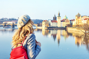 Aluminium Prints Prague Tourist girl dicovering Prague, Czeh Republic. Charles bridge view on background. Beauty city scape