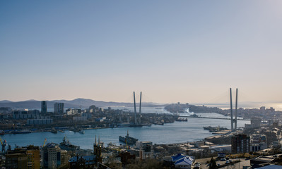 Wall Mural - Vladivostok cityscape, sunset view. Color toned.