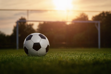 Soccer ball in the sunset