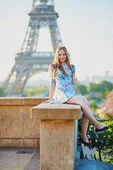 Girl in blue dress near the Eiffel tower, Paris