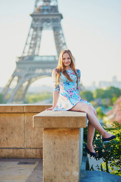 Girl in blue dress near the Eiffel tower, Paris