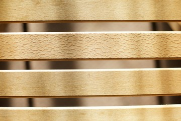 Strips processed light wood as a design on the street or in furniture