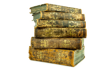 Six aged ancient old leather books stacked, studio shot on white.