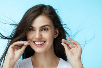 Dental Care. Beautiful Woman Flossing Teeth