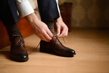 Men's shoes and the man who tie laces