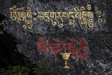 Tibetan writing on a rock