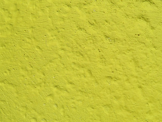 Yellow concrete wall texture. Painted amber rough background