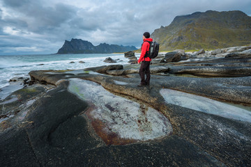 Wall Mural - Hiker at Uttakleiv beach on Lofoten island