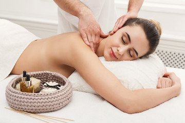 Woman getting classical back and neck massage