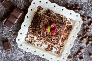 Homemade Tiramisu Cake Dessert with Grated Chocolate, Raspberry and Mint