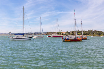 Yachts ships in the bay of the river Alvor.