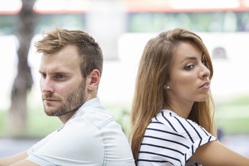 Side view of unhappy couple not speaking after having dispute. Concept of love problems