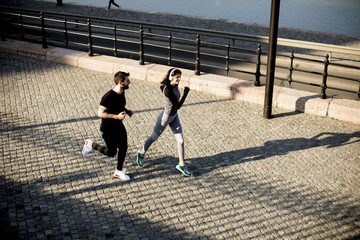 Healthy runners running in the city with cityscape background
