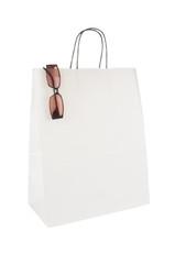 Shopping bag and eyeglasses isolated on white background