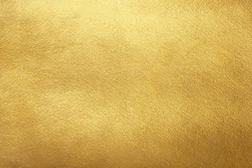Gold background. Rough golden texture. Luxurious gold paper template for text design, lettering. Wall mural