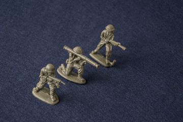 Miniature toy soldiers. Plastic toy military men at war.
