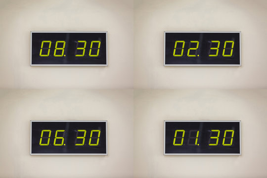 Black digital clock on a white background showing time 8 hours 30 minutes A digital alarm natural reflection