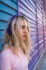 Young woman with purple headphones