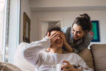 Couple in pajamas having fun