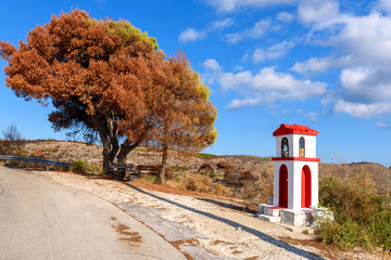 Little chapel and pine tree on coast of Zakynthos island. Greece