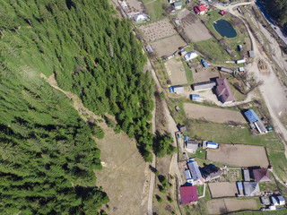 aerial view of forest and village in countryside of Petru Voda, Romania
