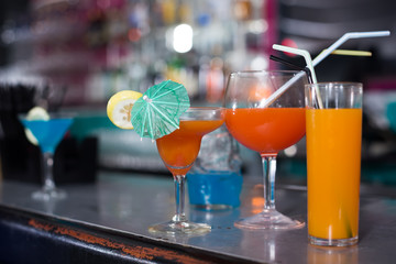 Image of colorful cocktails on the bar counter