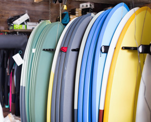 Image of colorful surfboard standing in store