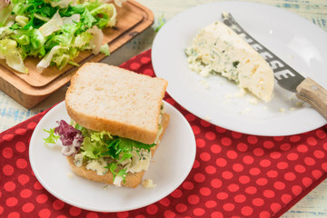 Vegetarian sandwich with salad and blue cheese on a wooden background. Healthy Diet