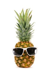 Hipster pineapple with trendy sunglasses isolated on a white background