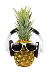Hipster pineapple with trendy sunglasses and headphones isolated on a white background