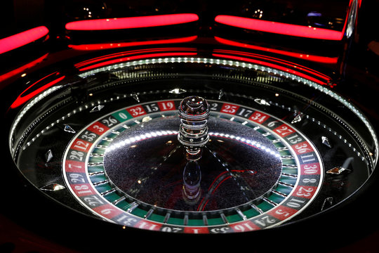 The spinning wheel on an electronic Roulette table is seen at the Dragonara Casino in St Julian's