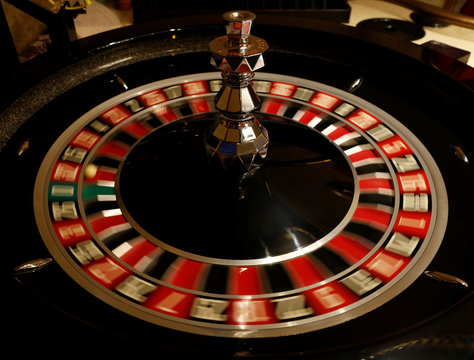 The spinning wheel on a Roulette table is seen at the Dragonara Casino in St Julian's