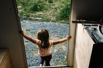 Young girl leaving camper