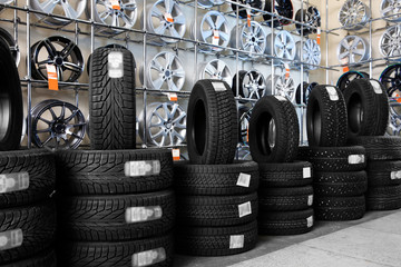 Car tires and alloy wheels in automobile service center