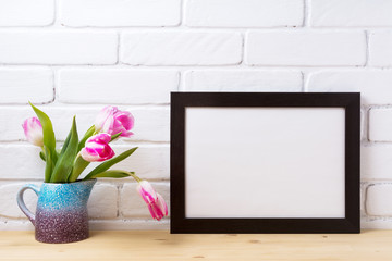 Black brown  landscape frame mockup with pink tulip in purple blue vase
