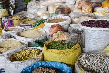 CUZCO, PERU - March 29, 2018: Grains and seeds on sale on a stall in Mercado San Pedro market