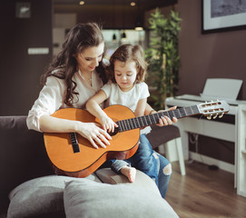 Printed kitchen splashbacks Artist KB Mother and daughter playing a guitar