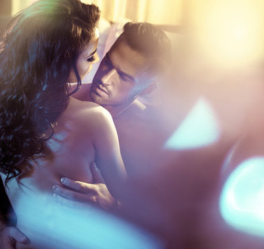 Sensual couple in a luxurious bedroom