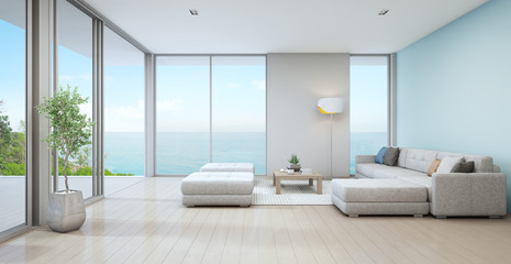 Wall Mural - Sea view living room of luxury beach house with indoor plant near glass door and wooden floor deck. Big white sofa against blue wall in vacation home or holiday villa. Hotel interior 3d illustration.